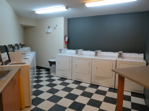 Apartment with laundry facility - Signature Club Suites